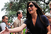 Actress Sandra Bullock reaches out to shake hands with a fan as she enters the Warren Easton Charter School in New Orleans. Bullock was there to cut the ribbon at the Warren Easton Charter School Health Clinic Sunday Aug. 29th 2010 on the 5th anniversary of Hurricane Katrina. BULLOCK SPEAKS ABOUT THE HEALTH CENTER AT THE EASTON SCHOOL. Photo © Suzi Altman