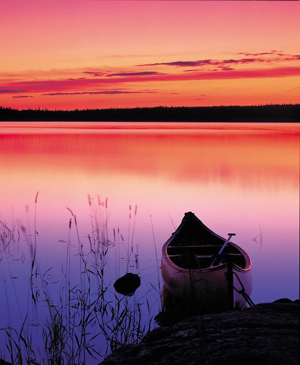 Canada. Yukon. Canoe in the waters of Yukon River.