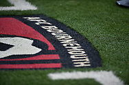 AFC Bournemouth badge logo side of the pitch during the Premier League match between Bournemouth and West Ham United at the Vitality Stadium, Bournemouth, England on 19 January 2019.