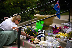 July 19, 2017 - Minneapolis, Minnesota, U.S. - ROBYN TRAXLER, a lifelong resident of the Linden Hills neighborhood, places flowers at the memorial for Justine Damond on the steps of the Lake Harriet Spiritual Community church in south Minneapolis on Wednesday. (Credit Image: © Aaron Lavinsky/TNS via ZUMA Wire)