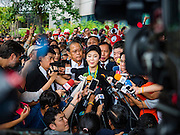 05 AUGUST 2016 - BANGKOK, THAILAND: YINGLUCK SHINAWATRA speaks to a crowd of her supporters at the Supreme Court of Thailand Friday. She appeared in court to start her legal defense. She was deposed by a military coup in 2014 and is being tried on corruption and mismanagement charges related to a price support plan for Thai rice farmers that was instituted while she was Prime Minister. More than two years after her government was deposed by a military coup, she is still a popular figure and hundreds of her supporters packed the area around the courthouse to greet her when she arrived at the Court.       PHOTO BY JACK KURTZ