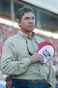 Texas Gov. Rick Perry stands for the National Anthem before the Sprint Cup NRA 500 at Texas Motor Speedway in Fort Worth on Saturday, April 13, 2013. (Cooper Neill/The Dallas Morning News)