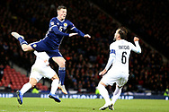 Scotland midfielder Callum McGregor (6) (Celtic) and Bibras Natcho (6) (Olympiacos)of Israel during the UEFA Nations League match between Scotland and Israel at Hampden Park, Glasgow, United Kingdom on 20 November 2018.