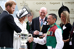 Jockey Frankie Dettori is presented with the trophy by the Duke and Duchess of Sussex after winning the St James's Palace Stakes on Without Parole during day one of Royal Ascot at Ascot Racecourse.