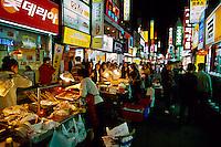 Koreans eating at street food stalls in the Sonmyon district of Pusan (Busan), South Korea