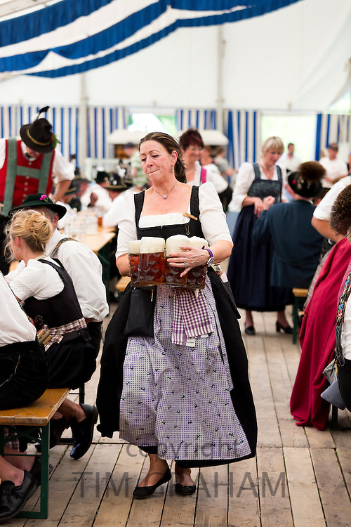 Woman in costume as serving wench at beer festival in the village of Klais in Bavaria, Germany