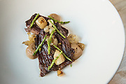 Skirt steak with onions and sea beans.