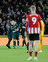 SHEFFIELD, ENGLAND - DECEMBER 05: <br /> Sheffield United players are stunned as Newcastle United celebrate a Jonjo Shelvey (No.8) goal awarded by VAR during the Premier League match between Sheffield United and Newcastle United at Bramall Lane on December 5, 2019 in Sheffield, United Kingdom. (Photo by Rich Linley - CameraSport via Getty Images)