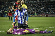 Atdhe Nuhiu (Sheffield Wednesday) has clattered into Alex Smithies (QPR) who is laying injured on the floor. Atdhe Nuhiu (Sheffield Wednesday) shows concern for the goalkeeper during the Sky Bet Championship match between Sheffield Wednesday and Queens Park Rangers at Hillsborough, Sheffield, England on 23 February 2016. Photo by Mark P Doherty.
