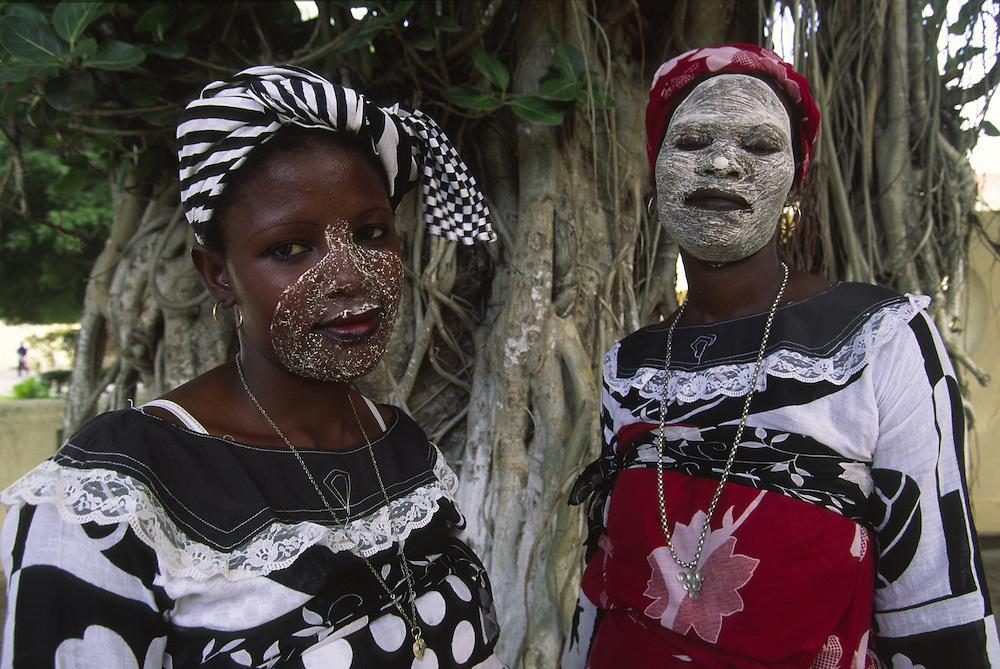 Makua women wearing traditional mussiro facial masks. Makua tribe is the predominant ethnic group in Ilha de Mozambique