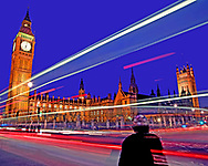 This is a fantastic example of low light photography, in this image I have managed to use the technique to bring the life and energy around the Houses of Parliament  at Westminster Abbey  in London in to the photograph. The photo was taken from Parliament Square, when I took the image I was lucky enough to be given a silhouette of a passing cyclist mixed in with the bright lights of the city behind.<br /> <br /> This has allowed the image to draw us in to the the life in urban London. We are shown the colour and energy brought by mans industrial machines and still reminded of how it is the people navigating their way through this chaos who inhabit and bring to life our massive cities.