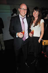 TOBY YOUNG and his wife CAROLINE at a party to launch Esquire magazine's June issue hosted by new editor Alex Bilmes at Sketch, Conduit Street, London on 5th May 2011.