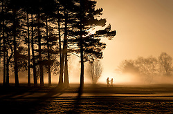 © Licensed to London News Pictures. 16/02/2016. Walton Heath, UK. People walk near Walton Heath golf course as the sun rises.  Temperatures locally were as low as -5 centigrade. Photo credit: Peter Macdiarmid/LNP
