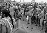 Naga Sadhus (Holy men) congregate in preparation for their holy bath during Kumbh Mela in Prayagraj, India.