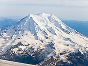 """In altitude, Washington varies from sea level up to 14,411 feet (4,392 meters) at the summit of Mount Rainier, which is the highest peak in the Cascade Range. With 26 major glaciers, Mount Rainier is the most heavily glaciated peak in the lower 48 states, with 35 square miles (91 km²) of permanent snowfields and glaciers. This active stratovolcano (composite volcano) is in Pierce County, 54 miles (87 km) southeast of Seattle. Global warming and climate change: Mount Rainier's glaciers shrank 22% by area and 25% by volume between 1913 and 1994 in conjunction with rising temperatures (Nylen 2004). As of 2009, monitored glaciers are continuing to retreat (NPS). Over the last century, most glaciers have been shrinking across western North America (Moore et al. 2009) and the globe (Lemke et al. 2007) in association with increasing temperatures. Published in """"Light Travel: Photography on the Go"""" book by Tom Dempsey 2009, 2010."""
