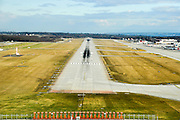 runway approach shot Geneva International Airport (IATA: GVA, ICAO: LSGG), commonly known as Cointrin Airport, Switzerland
