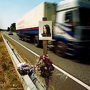 A memorial has been placed where ?Amy? died on the A27 near Binstead, Sussex, England. If we drove past this place where someone's life ended, the victim would just be a statistic but flowers are left to die too with touching poems written by family and loved-ones: ?To Amy (aged 14)/In my heart there is a picture worth more than silver and gold/it is a picture of my auntie Amy/whose memory will never grow old/Death comes so very quick/you never know when you?re going to be picked.? From a project about makeshift shrines: ?Britons have long installed memorials in the landscape: Statues and monuments to war heroes, Princesses and the socially privileged. But nowadays we lay wreaths to the ordinary who die suddenly - killed as pedestrians, as drivers or by alcohol, all celebrated on our roadsides and in cities with simple, haunting roadside remembrances