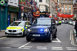© Licensed to London News Pictures. 04/02/2020. London, UK. Specialist Police officers arrive in Dean Street in Soho which remains closed for a second day after a part of an Unexploded WW II Bomb was discovered . Photo credit: George Cracknell Wright/LNP