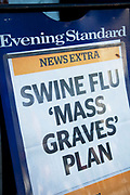 Sign on an Evening Standard newspaper stand warning of Swine Flu Mass Graves.