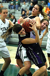 25 November 2014:  Rebekah Ehresman caught between Abbie Reeves and Lisa Palmer during an NCAA women's division 3 CCIW basketball game between the Wisconsin Whitewater Warhawks and the Illinois Wesleyan Titans in Shirk Center, Bloomington IL