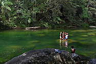 Indigenous children playing in Mossman River at Mossman Gorge.  Far North Queenslan