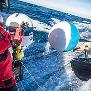 Leg 7 from Auckland to Itajai, day 05 on board MAPFRE, drifter buoy deployment, Guillermo Altadill. 21 March, 2018.