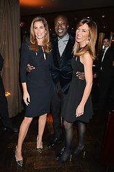 Left to right, CINDY CRAWFORD, OZWALD BOATENG and HEATHER KERZNER at the OMEGA VIP dinner hosted by Cindy Crawford and OMEGA President Mr. Stephen Urquhart held at aqua shard', Level 31, The Shard, 31 St Thomas Street, London, SE1 9RY on 10th December 2014.
