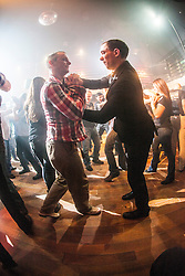 Students work with a hand grip. IKMS 'In The Club' seminar with KMG Global Team Instructor and Expert Level 5, Tommy Blom, at the Buff Club in Glasgow's City Centre. Bringing Krav Maga training out with the confines of the gym into a real nightclub/bar.<br /> © Michael Schofield.