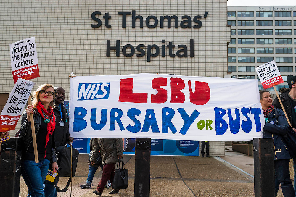 Doctors are joined by nurses who will see their training bursaries cut in 2017 - The picket line at St Thomas' Hospital. Junior Doctors stage another 48 hours of strike action against the new contracts due to be imposed by the Governemnt and health minister Jeremy Hunt.