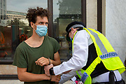 Police arrest a man who attempted to climb the Shell building as part of Extinction Rebellion 'Shell Out' protest on 8th September 2020 in London, United Kingdom. The environmental group gathered outside the Shell building to protest at the ongoing extraction of fossil fuels and the resulting environmental record. Extinction Rebellion is a climate change group started in 2018 and has gained a huge following of people committed to peaceful protests. These protests are highlighting that the government is not doing enough to avoid catastrophic climate change and to demand the government take radical action to save the planet.