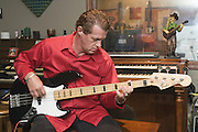 """Wise """"Doc"""" Smith plays electric bass in the live recording room, Thursday, July 26, 2012, at Liquid Sound Studios in Greenville, Ind. (Photo by Brian Bohannon)"""