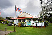 Hawaiian State Flag flying outside the North Kohala Civic Center. Kapa'au, Big Island, Hawaii RIGHTS MANAGED LICENSE AVAILABLE FROM www.PhotoLibrary.com