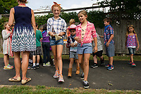 Jenna, Nyla, Carter, Remy, Natalie and Jakoby cash their gold at the bank during Pleasant Street School's Gold Rush on Thursday afternoon.  (Karen Bobotas/for the Laconia Daily Sun)