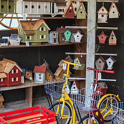 Intercourse, PA, USA - March 13, 2012: Bird houses, bikes, and a wagon for sale at a shop in Intercourse, PA