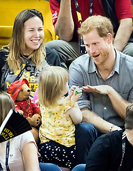 Prince Harry plays with Emily Henson, daughter of Hayley Henson (left) as he attends the Sitting Volleyball Finals at Mattamy Athletic Centre during the 2017 Invictus Games in Toronto, Canada.
