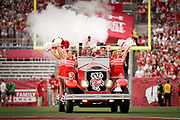 The Bucky Wagon is driven onto to field before an NCAA college football game between Wisconsin and against Eastern Michigan Saturday, Sept. 11, 2021, in Madison, Wis. The Bucky Wagon is a restored 1932 LaFrance fire engine. (AP Photo/Andy Manis)