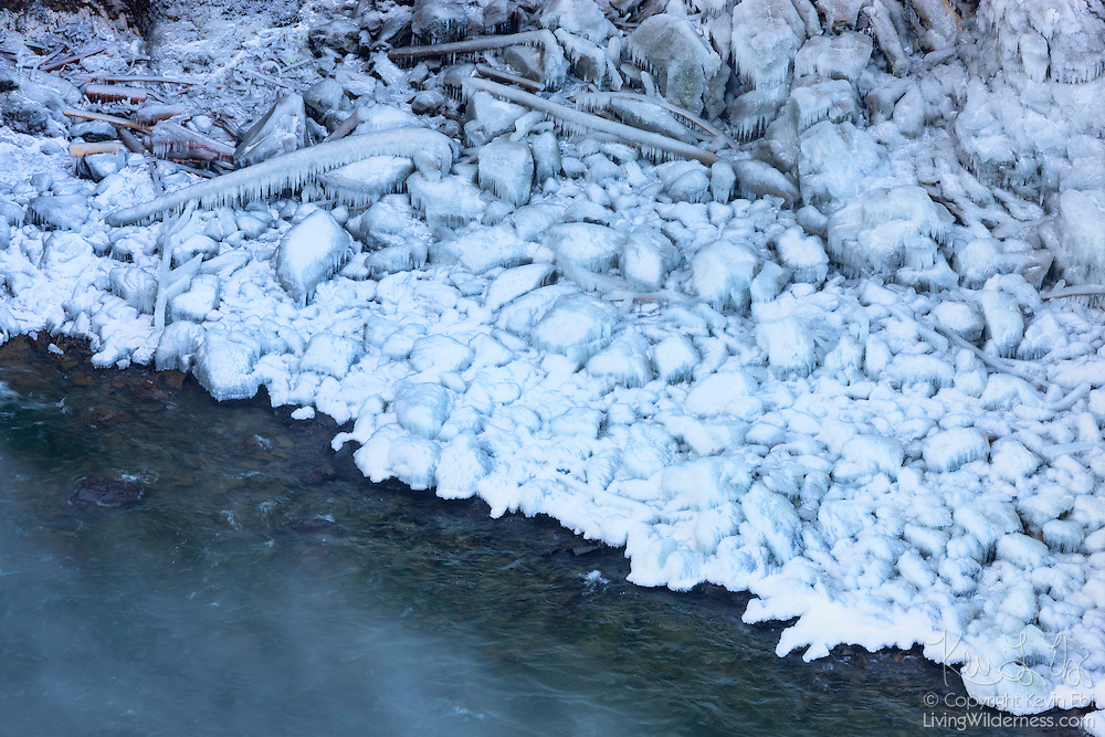Rocks and logs on the banks of the Snoqualmie River near Snoqualmie, Washington are encased in thick ice after several days of subfreezing temperatures. During the winter, temperatures occasionally drop so low that mist from the nearby Snoqualmie Falls turns to ice.