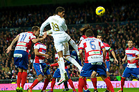 20120107: MADRID, SPAIN - BBVA League: Football macht between Real Madrid C.F vs Granada in Santiago Bernabeu, Madrid, Spain.<br /> In photo: Varane(C) figth the ball.<br /> PHOTO: CITYFILES