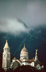 Cathedral in the mountains with clouds in Belize.