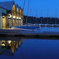 The Butler boathouse at Wellesley College on a beautiful spring night. The beautifully lit Lake Waban boathouse with its sailboats was beautifully reflecting in the quiet water of Lake Waban at the blue hour. This boathouse supports Wellesley athletics and recreational programs and is home to the crew team and sailing team. It provides recreational access to the lake for students. Wellesley College is a private, women's, liberal-arts college located in the town of Wellesley, Massachusetts. It is ranked the third best liberal arts college in the United States. Notable alumnae include Hillary Clinton, Madeleine Albright, Soong Mei-ling, Cokie Roberts, and Diane Sawyer. <br /> <br /> Wellesley College Butler Boathouse photography images are available as museum quality photography prints, canvas prints, acrylic prints or metal prints. Prints may be framed and matted to the individual liking and room decor needs:<br /> <br /> https://juergen-roth.pixels.com/featured/wellesley-college-boathouse-juergen-roth.html<br /> <br /> Good light and happy photo making! <br /> <br /> My best, <br /> <br /> Juergen <br /> Wall Art Prints: http://www.RothGalleries.com <br /> Photo Blog: http://whereintheworldisjuergen.blogspot.com <br /> Twitter: https://twitter.com/naturefineart <br /> Facebook: https://www.facebook.com/naturefineart <br /> Instagram: https://www.instagram.com/rothgalleries