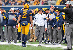 Nov 23, 2019; Morgantown, WV, USA; West Virginia Mountaineers head coach Neal Brown talks with West Virginia Mountaineers quarterback Jarret Doege (2) after a third down stop by Oklahoma State Cowboys during the first quarter at Mountaineer Field at Milan Puskar Stadium. Mandatory Credit: Ben Queen-USA TODAY Sports
