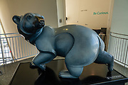 "The Polar Bear ""Arctic Shadow"" statue was cast in bronze with light granite gray patina by Jacques and Mary Regat in 1996. Dramatic architecture and distinctive exhibit galleries make the Museum of the North a must-see destination at the University of Alaska, in Fairbanks, Alaska, USA."
