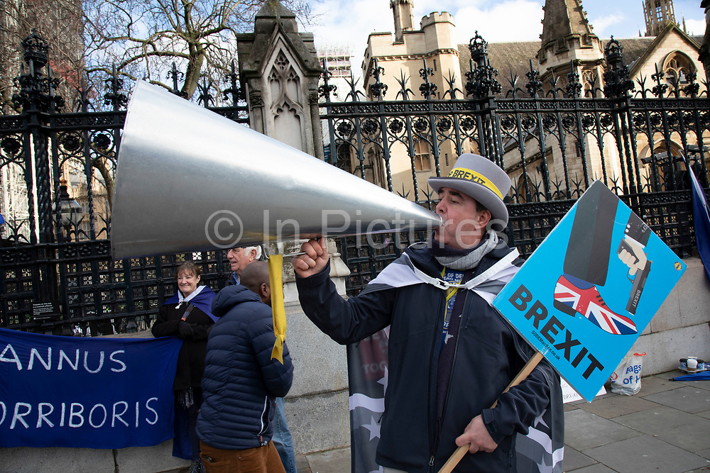 Anti Brexit protester Steve Bray wearing his new black and grey UK and European Union flags which he says are due to feeling sombre at Westminster outside Parliament on 15th January 2020 in London, England, United Kingdom. With a majority Conservative government in power and Brexit day at the end of January looming, the role of these protesters is now to demonstrate in the hope of the softest Brexit deal possible.
