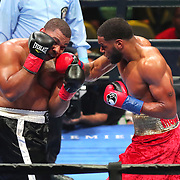 Mario Moore lands a right hand to the face of Thomas Hawkins during a Premier Boxing Champions fight on Saturday, August 4, 2018 at the Nassau Veterans Memorial Coliseum in Uniondale, New York.  (Alex Menendez via AP)