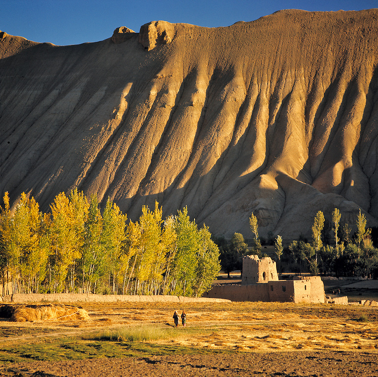 Sunset light creates deep shadows in the creases of the hillside in rural Bamian Valley, Afghanistan.