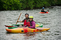 """Chris Loomis and Jean Slade are all smiles as they finish a run during """"Winni River Days"""" Satuday afternoon at Franklin's whitewater festival.  (Karen Bobotas/for the Laconia Daily Sun)"""