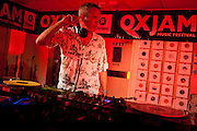 DJ Fatboy Slim plays Oxjam in the Tooting Oxfam charity shop. London.