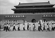 C008-21 Tom Hutchins_Young Pioneers and soldiers marching in front of Tien An Men, Peking (Beijing) 1956.tif