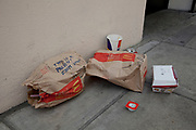 "Littering. Discarded fast food packaging in London. McDonalds trash. A tourist has written ""This is a present from Spain"" on the rubbish."