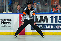 KELOWNA, BC - DECEMBER 30:  Referee Steve Papp stands at centre ice at the Kelowna Rockets against the Prince George Cougars at Prospera Place on December 30, 2019 in Kelowna, Canada. (Photo by Marissa Baecker/Shoot the Breeze)